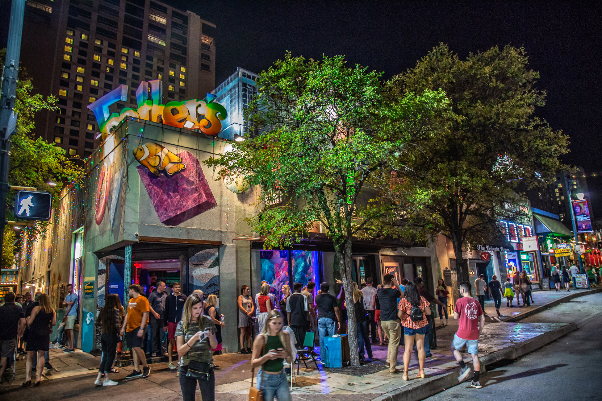 Patrons spill out after a show at the legendary Esther's Follies on 6th Street Austin, TX.  Photo: Will Taylor